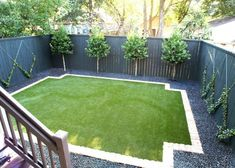 A brick border with notched corners encapsulates a crowned synthetic lawn creati. Lawn And Garden