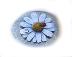 Hand Painted Stone Ladybug with Drop on a Daisy by RockArtAttack