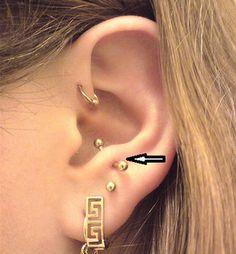 Piercings en cartílago de la oreja - Foto copyright Flickr (Galería Shae)