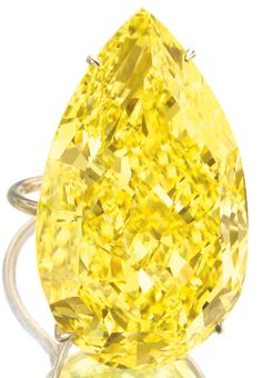 Disney Princess enagement rings: The Sun Drop diamond, a legendary 110.03 carat fancy vivid yellow pear-shaped diamond, shown here mounted on a gold ring setting. Via Diamonds in the Library.