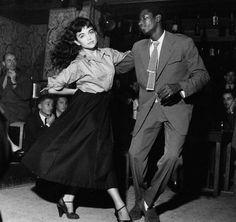 A young Parisian couple dancing to Bebop in the Bebop Cellar at Vieus Colombier