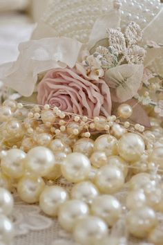 Pearls and pink rose...