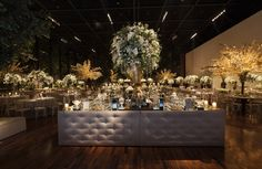 Beautiful bar for a white wedding decoration, with white flowers arrangements and mirror top