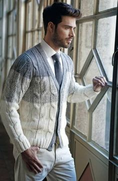 A beige shawl cardigan and cream chinos are a great outfit formula to have in your arsenal.   Shop this look on Lookastic: https://lookastic.com/men/looks/beige-shawl-cardigan-white-dress-shirt-beige-chinos/15877   — White Dress Shirt  — Grey Knit Tie  — Beige Shawl Cardigan  — Beige Chinos
