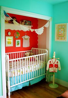 Love this colorful nursery area- making use of a closet space!