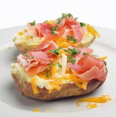Baked Potato with Ham and Cheese via SheKnows