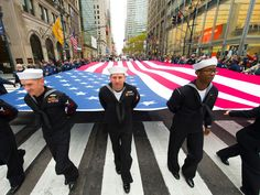 U.S. Navy sailors helps to carry the flag during New York City's Veterans Day parade.  Robert Deutsch, USA TODAY