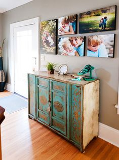 I adore these large canvas color prints of the family! And the antiqued dresser/console. Tina Wilson