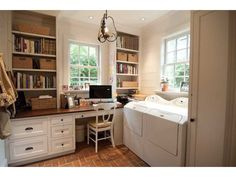 I wouldn't mind doing laundry in this laundry room and office. Great light fixture.
