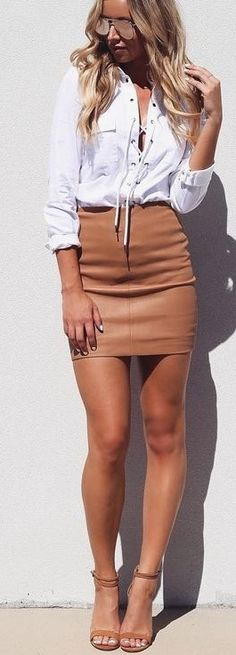 Laced Up Shirt + Leather Skirt                                                                             Source