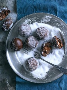 Chocolate round donuts with gooey centers and dusted with sugar.  Chris Court Photography