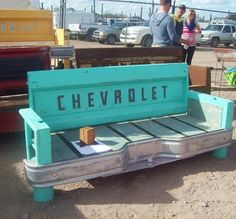 Recycled pick-up truck tailgate into a bench! I wish I had the instructions, but I'm sure your man would be happy to help with this! SO neat!!