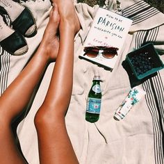 tanning tan skin summer blueberries book sunglasses drink sun sunny bright Parisian shoes