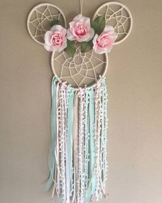PINK AND MINT MINNIE MOUSE INSPIRED DREAMCATCHER Beautifully crafted one of a kind dreamcatchers. Perfect for: home decor, nurseries, childrens bedrooms, birthdays, parties, photo props, and much more! Handmade in NJ. Large Size Minnie Mouse Dreamcatcher Made with 8 and 5 inch rings.