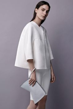Renowned New York City-based designer Narciso Rodriguezdisplays his signature minimalistforms and sensualsilhouettes in his Resort 2015 collection withunderstated details ofgeometric cutouts, simple lines that highlight the anatomyand even a twist of floral prints reduced to a pure bold graphic.