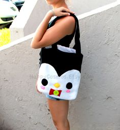 Cute penguin tote bag is so convenient when you have to carry so many notebooks to school or to take a stroll around town. Its cute pink blush and red bow tie tied down by a big green button add a unique detail to the bag. It has plenty of room to carry all of your items. The outer shell