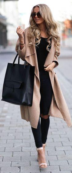 Shop this look on Lookastic:  http://lookastic.com/women/looks/sunglasses-coat-tank-tote-bag-skinny-jeans-heeled-sandals/6095  — Dark Brown Sunglasses  — Camel Coat  — Black Tank  — Black Leather Tote Bag  — Black Ripped Skinny Jeans  — Beige Leather Heeled Sandals