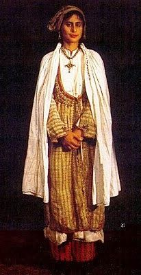 Greek costume of Karpasia, Cyprus. With an outdoor cape. 'Tsiofa's me ttellou'rka' embroidery. (Collection of the Cyprus Folk Art Museum). Greek Traditional Dress, Traditional Outfits, Arab Fashion, Fashion Women, Parka Style, Dance Costumes, Greek Costumes, African Culture, Folk Costume