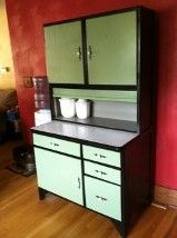 I found this old hoosier cabinet (it was in an old barn for years) and cleaned it all up and painted it fun colors :)