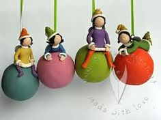 Polymer clay 'family members' for on each of the family member's bauble for Christmas