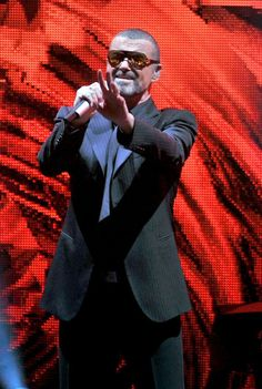 George Michael Photos Photos - George Michael performs his Symphonica concert at the Royal Albert Hall. - George Michael's Symphonica concert in London