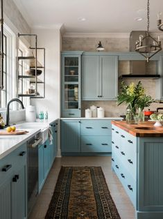 Pictures of the HGTV Smart Home 2018 Kitchen Blue kitchen cabinets + vintage rug + butcher block island countertop + farmhouse sink + industrial open shelving + industrial pendent lights Home Decor Kitchen, Kitchen Interior, New Kitchen, Home Kitchens, Kitchen Ideas, Kitchen Modern, Kitchen Layout, Kitchen Sink, Island Kitchen