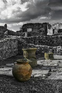 In the ancient city of Pompeii there are few artifacts remaining. Most have been looted over time and the rest are carefully preserved in the Pompeii museum in Naples. This is a photo of several storage vessels that are visible inside the walls of Pompeii.