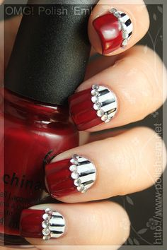 Half Moon Mani with a Berry Red, Black and White Stripes, and Rhinestones