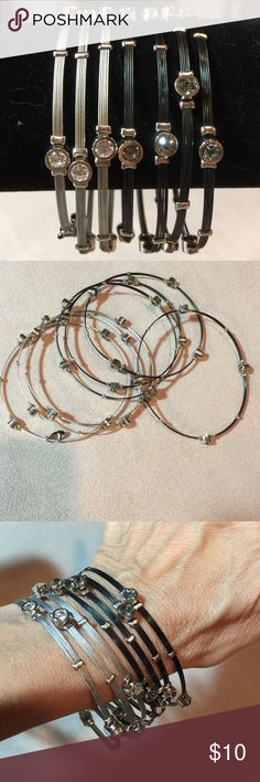 Cookie Lee Bangle Bracelets 7 bangles . 4 are black thin plastic wire and adorned with clear black stones in silver tone setting . 3 are silver thin plastic wire and are adorned with clear stones in silver tone setting. Cookie Lee Jewelry Bracelets