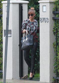 Nicole Richie in a Balenciaga leopard print sweater carrying a Céline bag