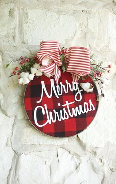 This unique Farmhouse Christmas wreath is made of Buffalo Plaid Flannel with Merry Christmas in white lettering in a embroidery hoop. The hoop has a custom barn wood finish for a Minimal Wreath feel. This custom finish is a gray brown finish much like the Printer cabinet in my living