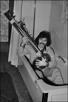 Black Sabbath guitarist, Tony Iommi in the tub with his sitar