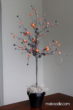 Halloween Tree DIY, grab a big branch from back yard and spray, then decorate
