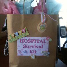 Hospital Survival bag. Filled w/ everything the new little Mommy will need while in the hospital: shampoo, conditioner, body wash, chapstick, face wipes, wisps, tissues, hand sanitizer, notepad and pen, snacks and chocolate , mints, gum, hair ties and headbands. The new dad has a small side too including vending machine change, Advil and a sleep mask!