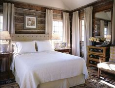 rustic romantic bedroom with white linen sheets and window treatments