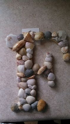 Sea shell craft - doing this with all of our shells from Destin with a W of course!