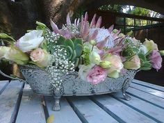 Lisianthus, roses, pink protea, succulents, baby's breath.