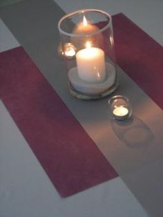 ribbon table runner with place mat (or some type of square fabric underneath and two smaller ribbons on the side?