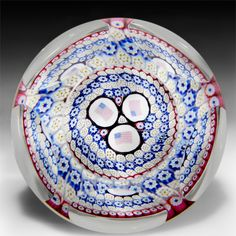 Whitefriars 1977 concentric millefiori with flags faceted glass paperweight. by  Whitefriars