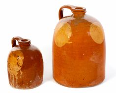 """Garth's 9/9/17 Lot 277.  Estimate: $ 350-550. Realized: $4,680.  TWO GALENA POTTERY JUGS.  Illinois, 2nd half-19th century. Applied strap handles & yellow glaze spots or """"moons"""". 8"""", 12.5""""h.   Larger has hairline in handle & glaze loss to top 1/3 of one of the yellow spots. Smaller has edge flakes on handle & glaze loss around the base, approx. 1"""" up the side."""