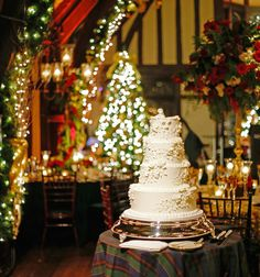 Wedding Cake in Christmas Theme Reception Room | Photography: Robyn Rachel Photography. Read More: https://www.insideweddings.com/news/planning-design/festive-decor-for-weddings-with-a-holiday-or-christmas-theme/2679/