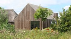 Julius Taminiau Architects has rebuilt a former cowshed to create The Potato Shed, a house clad in thin timber slats that conceal double-layered openings. Timber Slats, Timber Cladding, Wooden Slats, Cladding Systems, Through The Roof, Shed Homes, Vincent Van Gogh, Modernism, Ground Floor