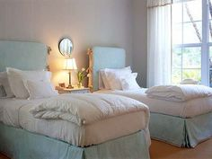 I love the slip-covered headboards! You could just get plain planks of wood and cover them!