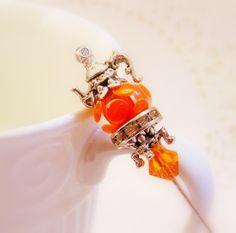 Beaded teapot hat pin tangerine spice swirl orange wonky polka dot lamp glass Victorian hat pin  scarf pin TAGT tenX.  via Etsy.