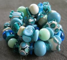 60 Handmade Lampwork Beads SRA Turquoise Ivory and Teal Beachy Beads - Love these beads, too!