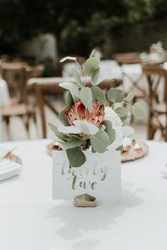 Whimsical DIY Garden Wedding at Botanica Wichita (Junebug Weddings) Wedding Table Centerpieces, Wedding Table Numbers, Diy Wedding Decorations, Flower Centerpieces, Reception Decorations, Table Decorations, Protea Centerpiece, Wedding Tables, Centerpiece Ideas