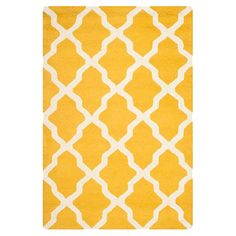 Anchor your living room seating group or define space in the den with this artfully hand-tufted wool rug, featuring a trellis motif for eye-catching appeal.