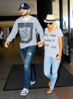 Christina Aguilera & Matthew Rutler Departing On A Flight At LAX. disressed jeans, text tee, hat.
