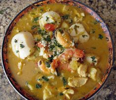 Sopa de mariscos (popular Latin, creamy, seafood soup in coconut milk)