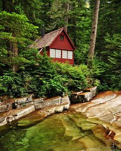 A summer cabin along Denny Creek near Snoqualmie Pass, Washington.  #tinyhousemovement #tinyhouse #simpleliving #washington #cabin #cottage #red